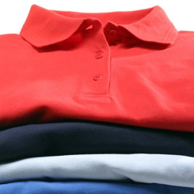 A stack of polo-shirts shot in the studio. The shirts are isolated in front of white background.